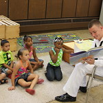 Seaman Apprentice Chris Donahue reads to children at the Cameron Community Ministries.
