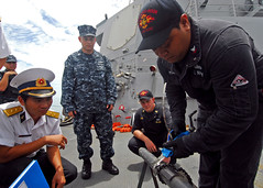 In this file photo, Damage Controlman 2nd Class Alvin Poai shows a group of Vietnamese sailors a procedure for patching a pipe during a damage control exchange aboard USS Chung-Hoon (DDG 93) in July 2011. (U.S. Navy photo by Mass Communication Specialist 1st Class Laurie Wood)