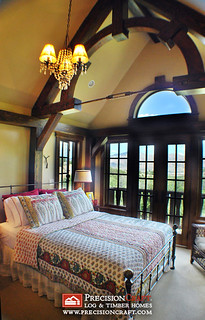 Upstairs Bedroom Featuring a Beautiful Timber Truss | Hybrid Log & Timber Home