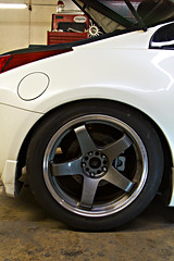 Powered By Max Pro-series Z33 install. Factory ride height. (Other side wasn't on, so it's a little higher than it really is.