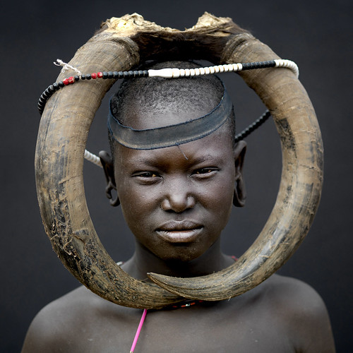 Mursi tribe imagination without border - Omo Ethiopia by Eric Lafforgue