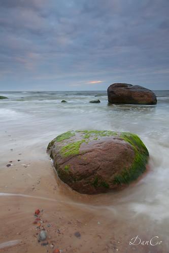 sunset sea stones baltic lithuania lietuva sigma1020mmf456exdchsm karkle canoneos50d cokinp121mfilter