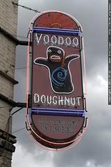 new neon sign @ voodoo doughnut in downtown portland
