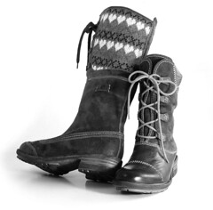 outdoor shoe(0.0), brown(0.0), motorcycle boot(0.0), limb(0.0), human body(0.0), snow boot(1.0), textile(1.0), footwear(1.0), shoe(1.0), leather(1.0), monochrome photography(1.0), black-and-white(1.0), boot(1.0),