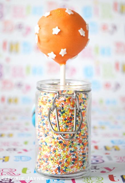 Starry orange cake pop
