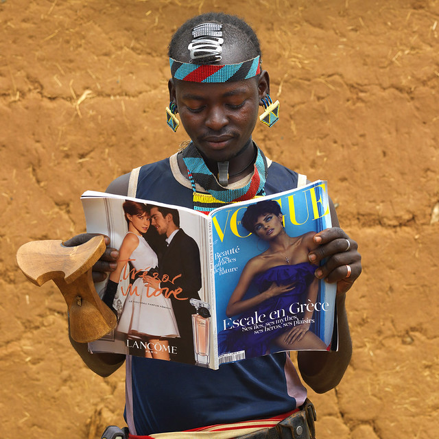 Tsemay warrior reading Vogue - Omo Ethiopia