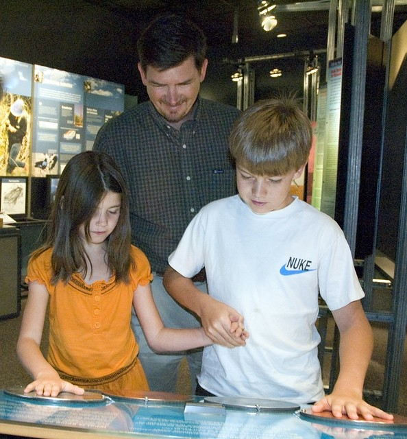 Brother and sister become more connected at the Bradbury Science Museum's exhibit on batteries. The Research Gallery helps you explore other areas of Laboratory work such as neutron science, brain imaging, and deciphering genetic codes.