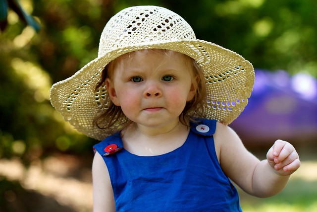 little old lady baby in gardening hat