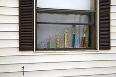 window(0.0), picture frame(0.0), window blind(0.0), interior design(0.0), door(0.0), design(0.0), lighting(0.0), balcony(0.0), window treatment(1.0), shelf(1.0), sash window(1.0), wall(1.0), wood(1.0), glass(1.0), window covering(1.0), facade(1.0),