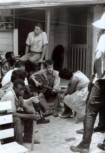 Bob Dylan in the backyard of the SNCC Office, Greenwood, Mississippi, July 8th, 1963, by Danny Lyon