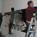 October 6, 2010 - 1:23pm - Installing an 17-foot photograph is a team effort.