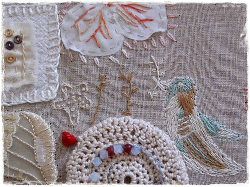 hand embroidered closeup of mixed media fabric collage