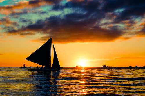 travel sunset sea sun reflection beach water silhouette clouds sailboat asian island boat nikon asia southeastasia waves horizon philippines insel tropical sail filipino boracay tropics visayas gettyimages philippinen d40