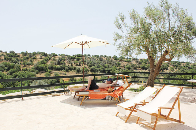 lounging poolside at relais parco cavalonga in ragusa, sicily