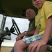Bryce catches a ride with our recruited grain cart operator- farmer dad