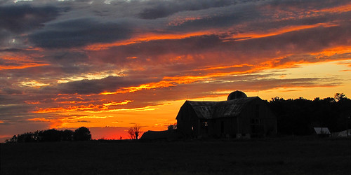 sunset silhouette barn
