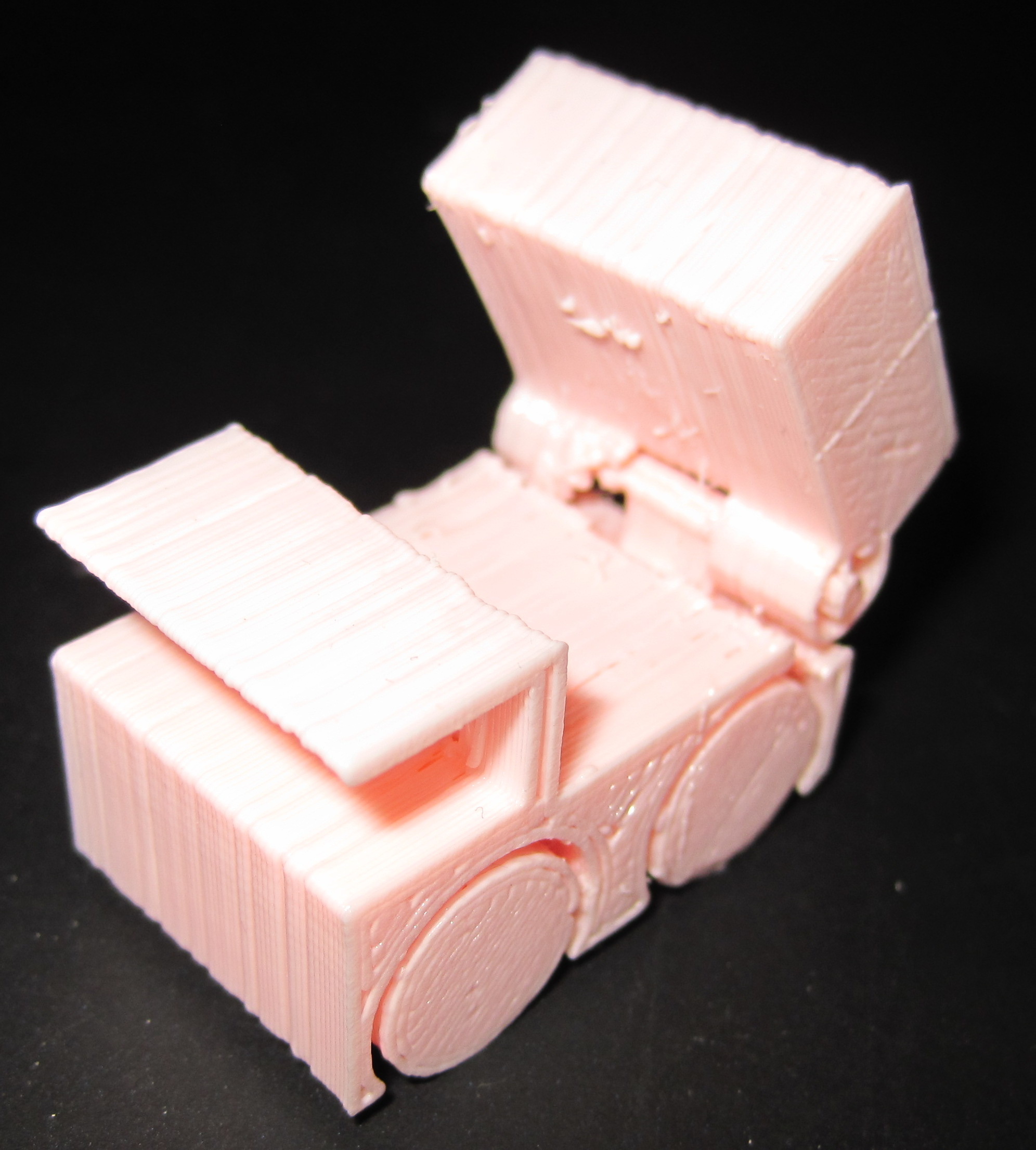 A 20mm high pink dump truck toy