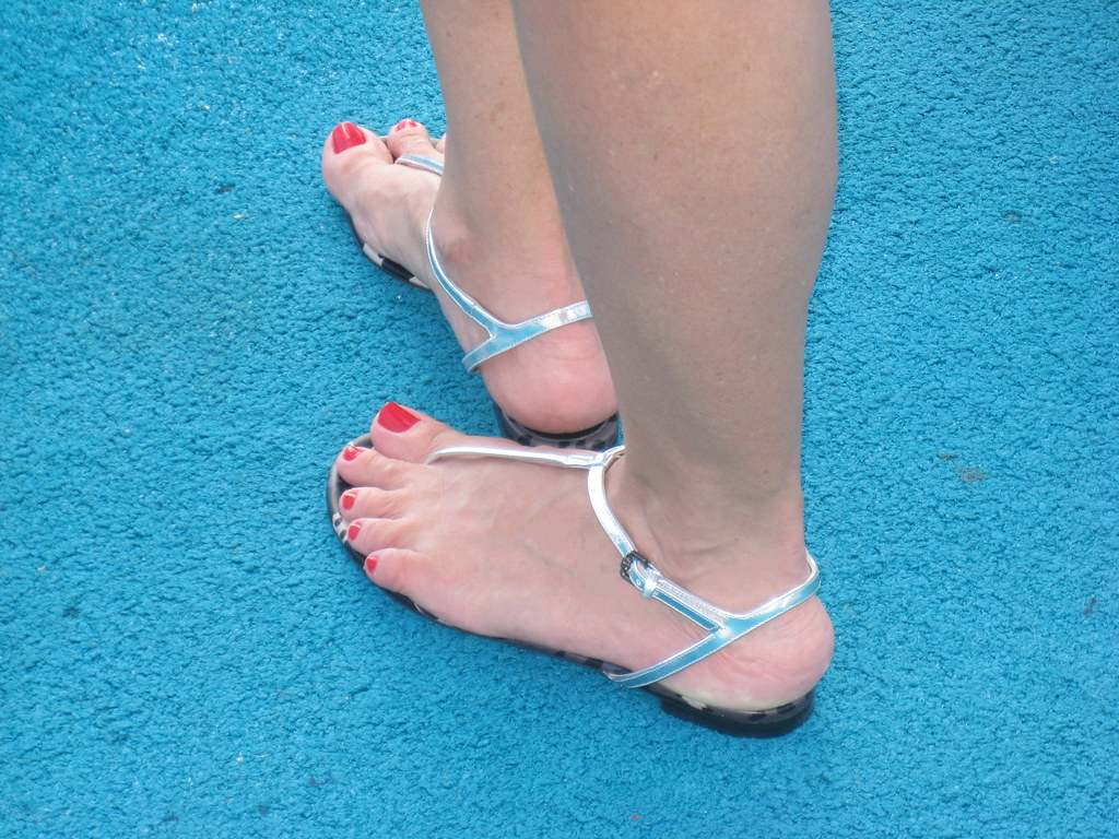 Candid feet in flip flops at store 3