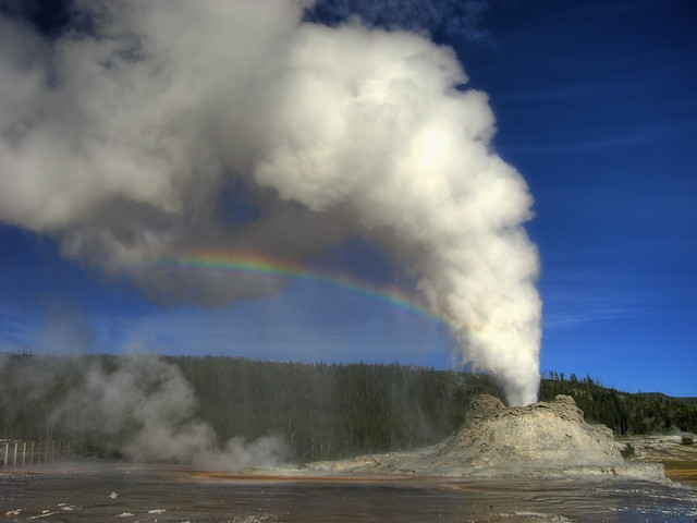 Eruption with rainbow at Castle Geyser