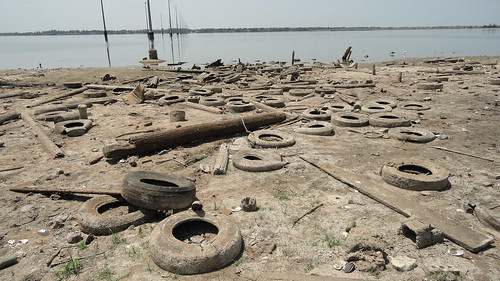 tires, litter on shoreline