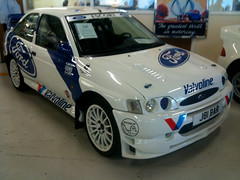 model car(0.0), renault clio v6 renault sport(0.0), ford focus rs wrc(0.0), touring car(0.0), race car(1.0), automobile(1.0), automotive exterior(1.0), rallying(1.0), vehicle(1.0), ford escort rs cosworth(1.0), world rally car(1.0), bumper(1.0), ford(1.0), sedan(1.0), land vehicle(1.0), luxury vehicle(1.0), sports car(1.0),