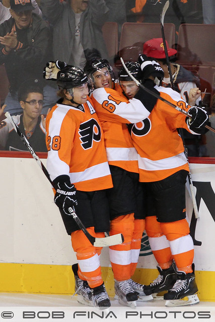 Tomas Hyka #61 of the Philadelphia Flyers celebrates his goal with Claude Giroux #28 and Matt Read #24