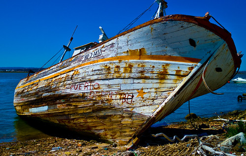 Dead fishing boat with graffiti, Spain