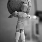 Wood doll and old tennis ball
