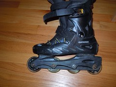 outdoor shoe(0.0), motorcycle boot(0.0), footwear(1.0), shoe(1.0), aggressive inline skating(1.0), roller skates(1.0), boot(1.0),