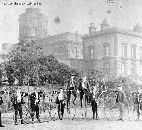 Group of cyclists with penny farthings outside Hyde Road Gaol, 1880