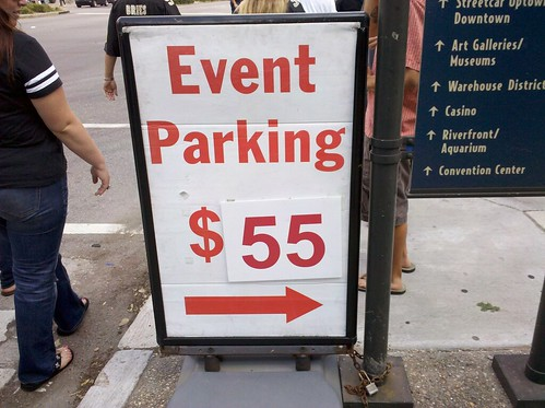 Library chronicles coke sprays bandit signs all over the for Mercedes benz superdome parking prices
