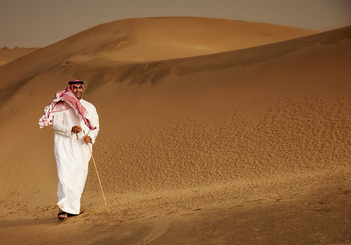 Kuwait - a Man Walking in the Desert