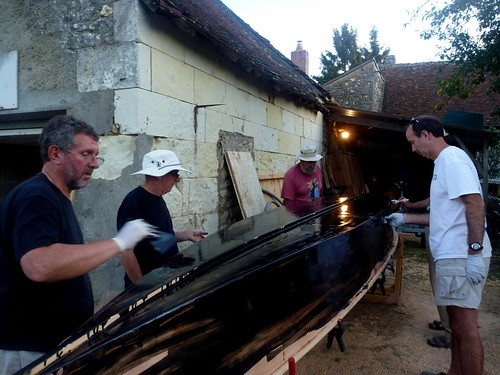 Coating the outside of the plywood canoe with epoxy and graphite.  There are many myths about this choice - see the article.