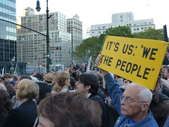 "Crowd with ""We the people"" sign"