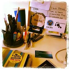 Corner of the desk.