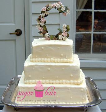 Flower initial wedding cake