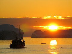 Coucher de soleil sur les icebergs dela baie de Disko