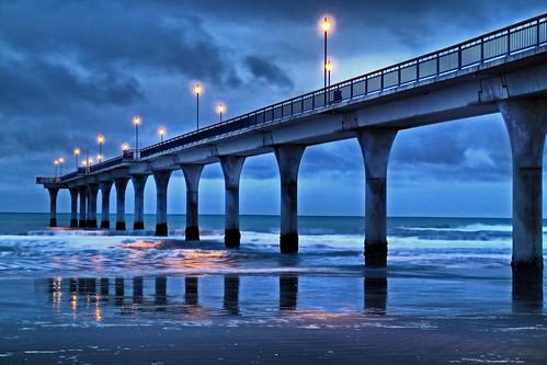 night photography shot newbrighton pier sea pacific ocean coast jetty waves dawn christchurch canterbury southisland nz newzealand colorphotoaward landscape sunrise daybreak sunup brilliant wow stevetaylor