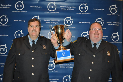 6222584349 0398025589 Clare Police Officers Greg Rynearson and Al White Pose for Pictures Following Winning 2011 Michigan Municipal League Community Excellence Award for Cops and Doughnuts Businesses