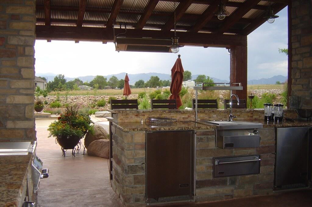Westminster custom home outdoor spaces wilder for Outdoor kitchen under deck
