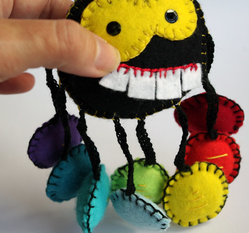 Spider stuffed with rainbow shoes