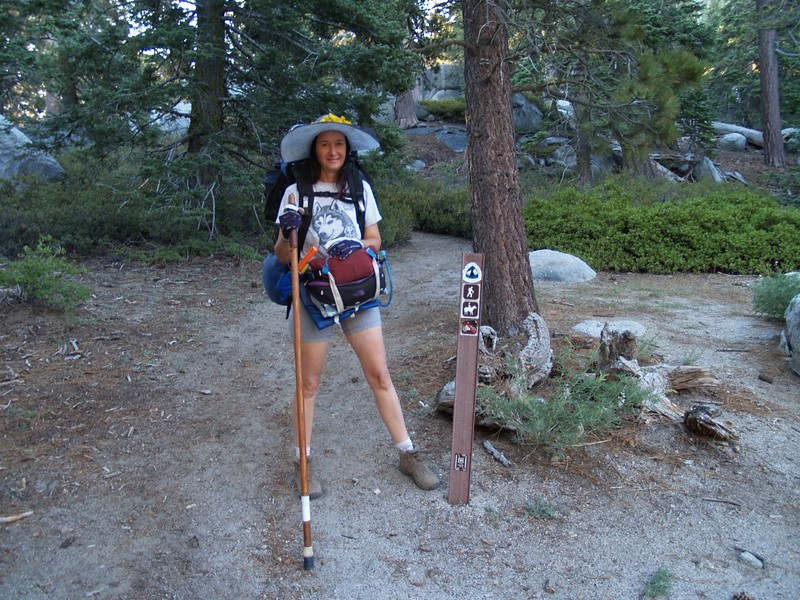 Vicki at the Fuller Ridge Trailhead with a small PCT Trail marker