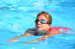 freestyle swimming(0.0), swimming pool(1.0), individual sports(1.0), swimming(1.0), sports(1.0), recreation(1.0), outdoor recreation(1.0), leisure(1.0), azure(1.0), swimmer(1.0), water sport(1.0), breaststroke(1.0),
