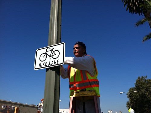 Alfred installs a bike lane sign