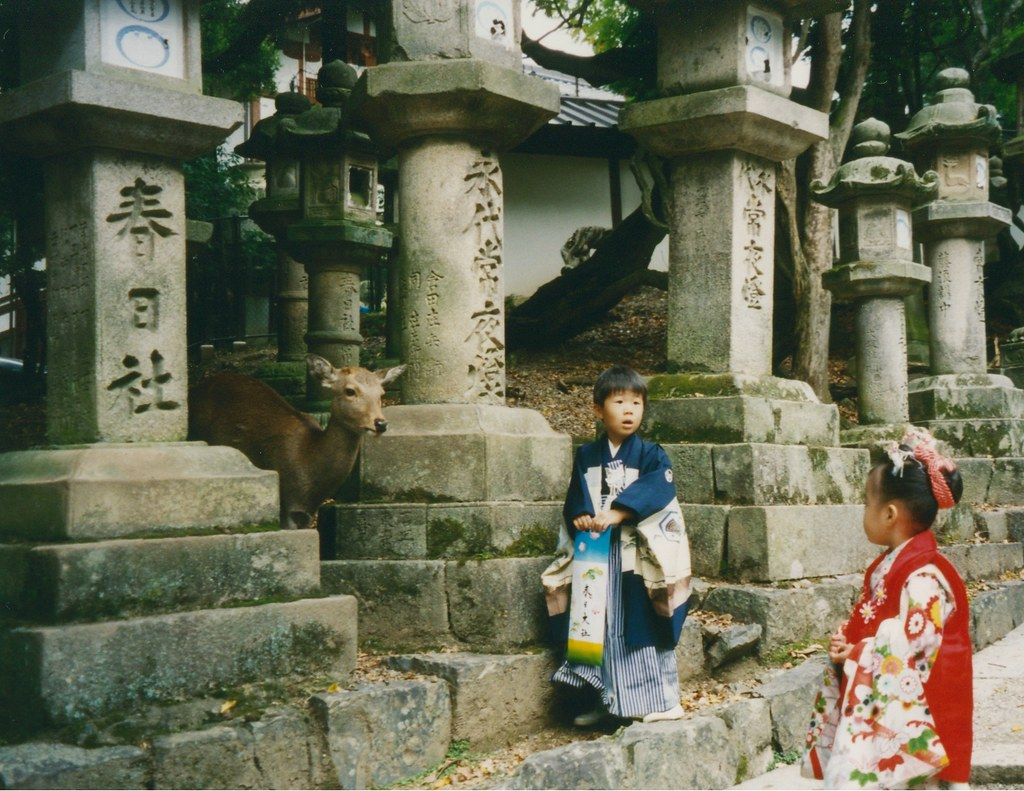 Nara, kids in traditional costumes with deer