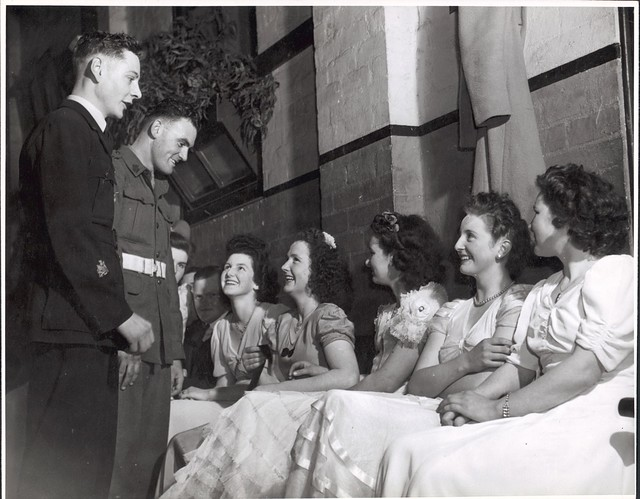 Wes Colquhoun and Fred Phair talking to the girls at the ball in the Soldier's Memorial Hall, Drouin, Victoria