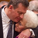 Attorney John Raley embraces Michael's mother, Patricia, at Michael's release hearing on October 4th, 2011