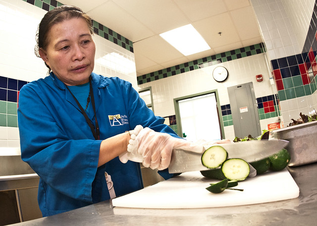 Food Service Manager Hoa Tran slices cucumbers for salads at the Nottingham Elementary School in Arlington, VA.  CC image courtesy of Lance Cheung USDAgov on Flickr