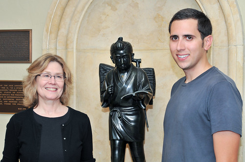 Associate Professor of Art History Susan Libby and Cory Baden (Class of 2012) with Kinjiro Statue
