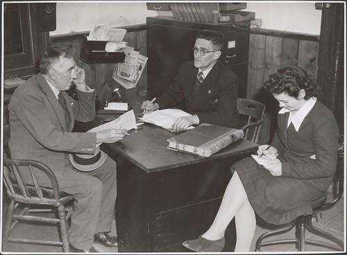 Drouin Shire Secretary Thomas J. Ryan (behind desk) talking to Councillor Frederick Lilley